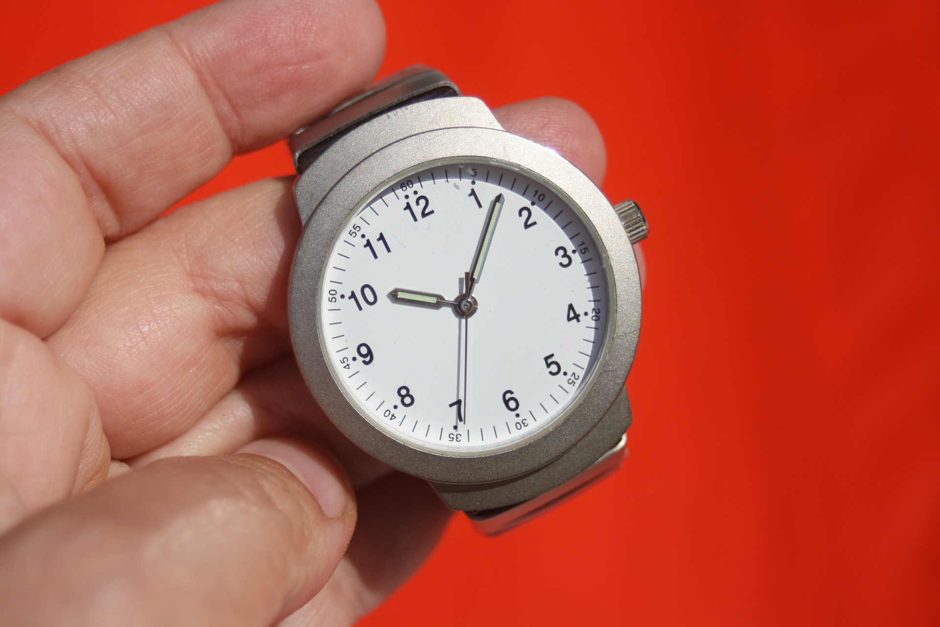 quick divorce in Florida - image of a wrist watch being held across a red background