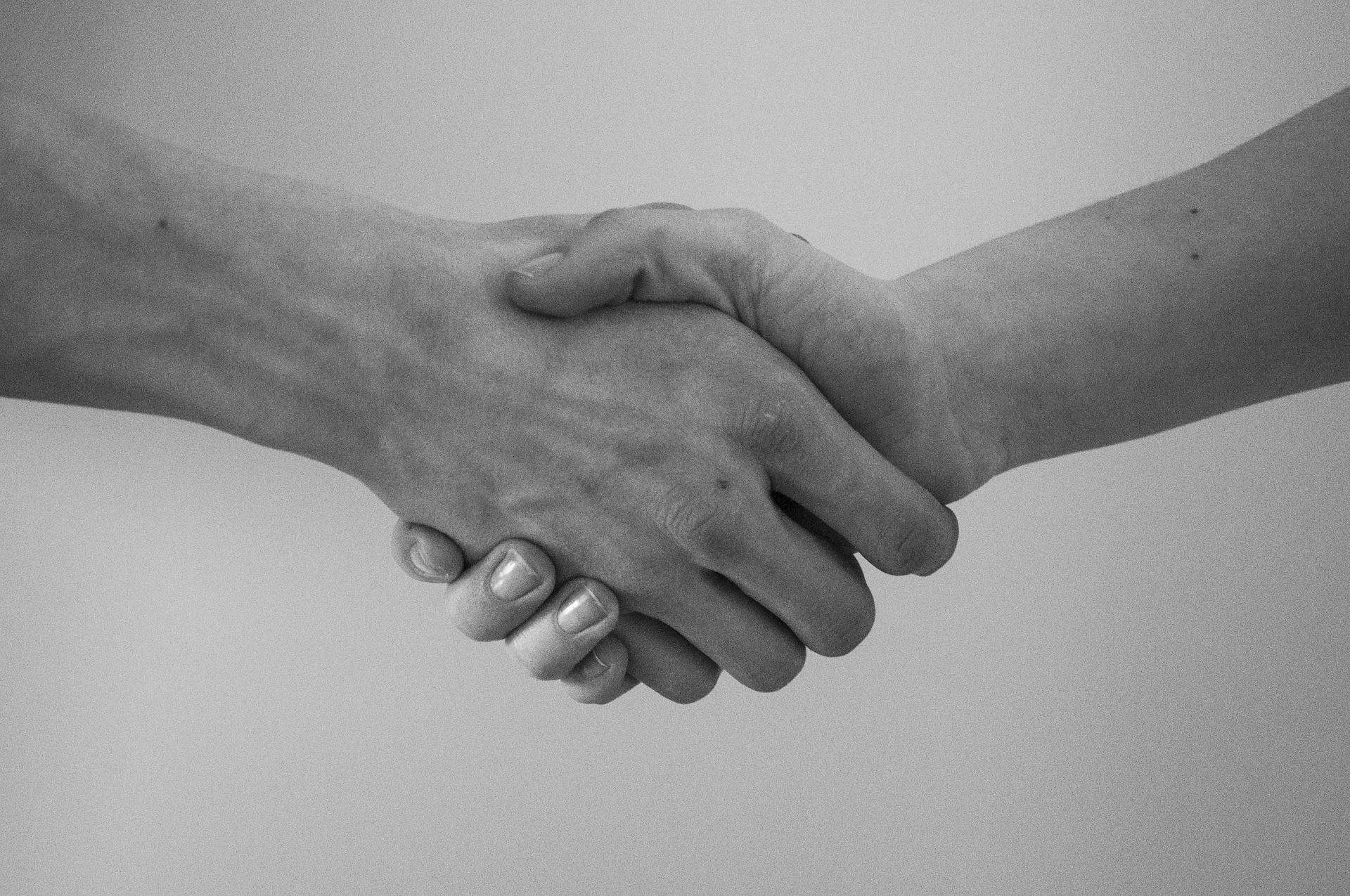Marital Settlement Agreement - image shows two adults shaking hands