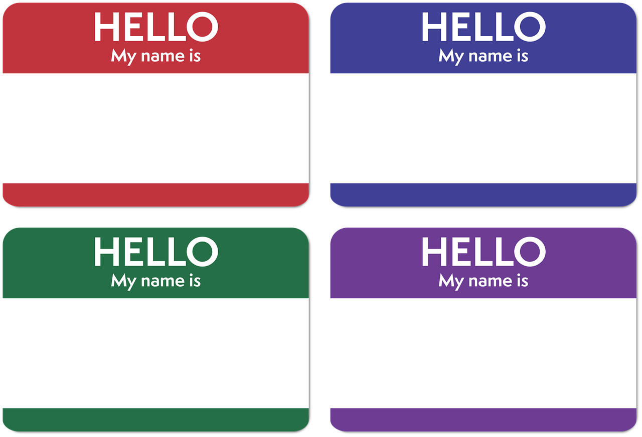 name change Florida - image of four colored name tags